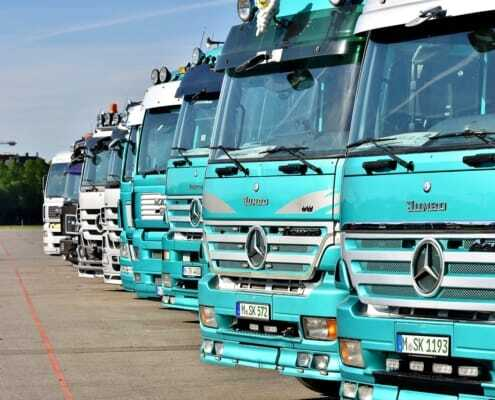 blue trucks in a row finished with heavy truck and trailer bonding adhesive