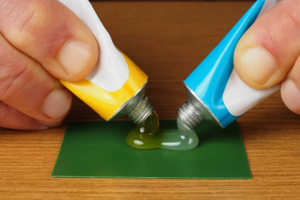 Mixing two component epoxy adhesives on green surface