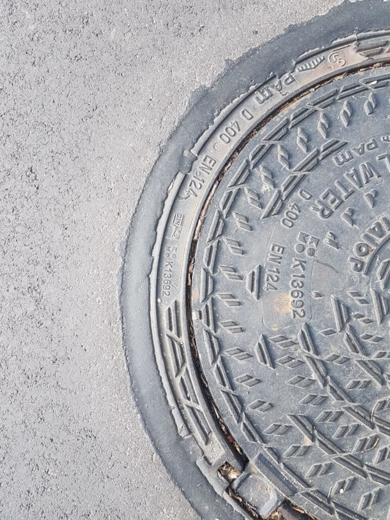 sealants for gas stations around a sewer lid