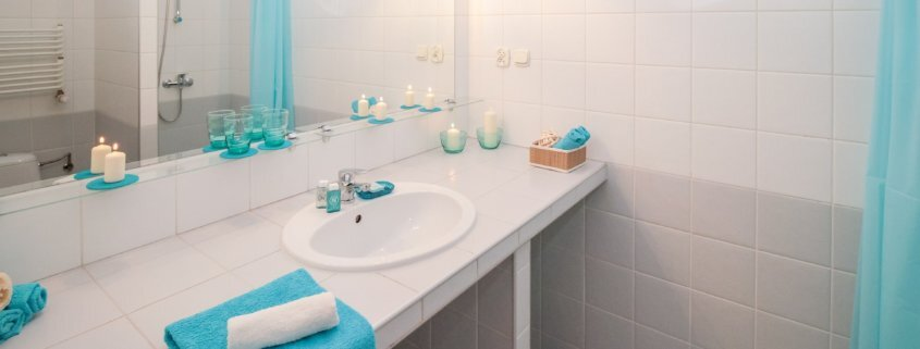 different types of sealants used in a bathroom with blue towels