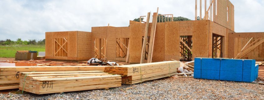 a wooden house being built using low carbon adhesives for construction