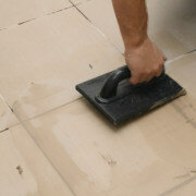 applying grout for natural stone with a trowel