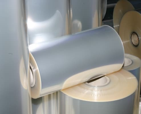 packaging film with biodegradable heat seal adhesive
