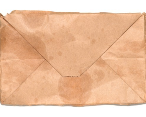 used paper bag with bio-based packaging adhesive