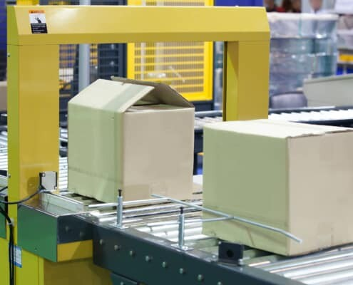 industrial packaging line where pressure sensitive hot melt adhesive is applied