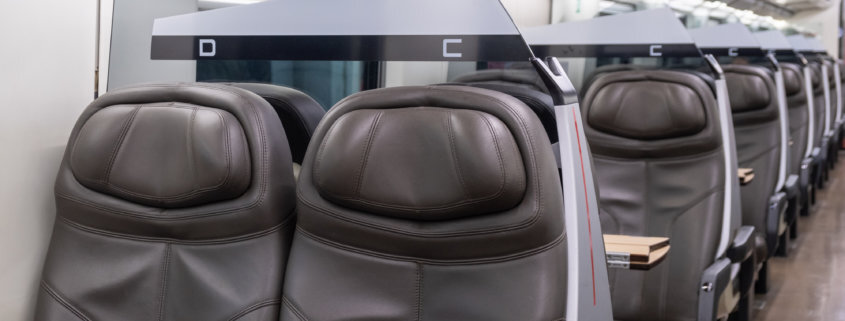 adhesive for railcar vehicle seats applied to seats in a train in Australia