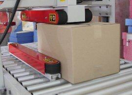 packaging line tape with hot melt pressure sensitive adhesive being applied on a parcel