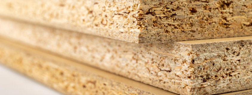 particleboard made stronger with reinforcement and anchoring adhesive