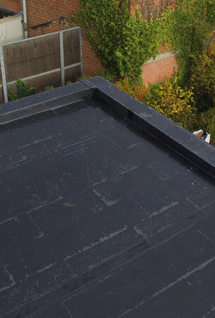Black EPDM roofing membrane on flat domestic roof