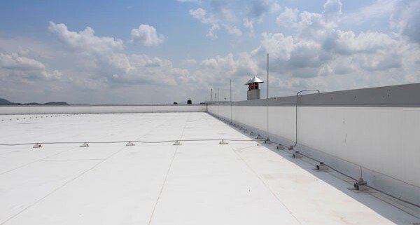 White PVC roofing membrane on flat industrial roof